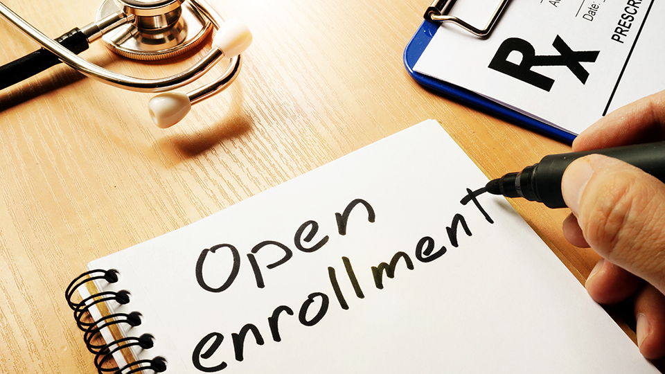open enrollment on note pad